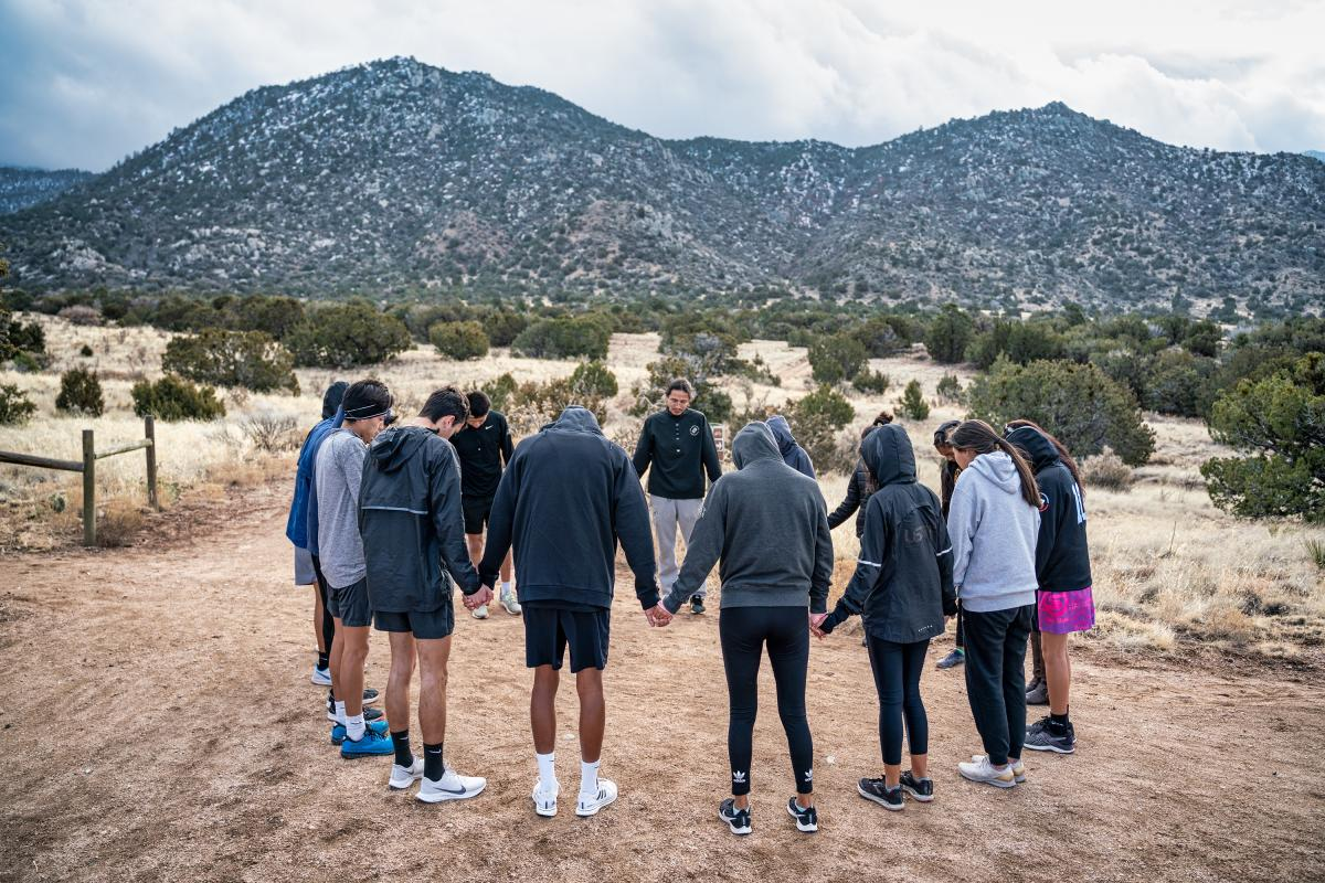 Team blessing of runners in Albuquerque