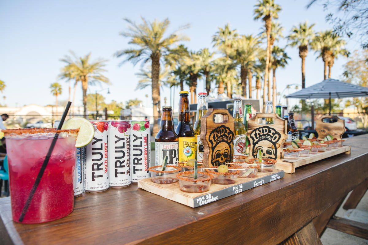 Indio Food Cart drinks and food in front of palm trees