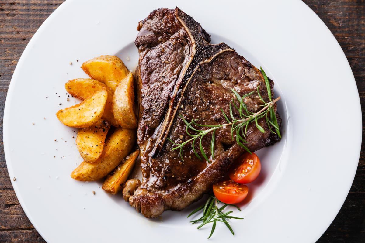 Juicy steak with a side of potatoes.