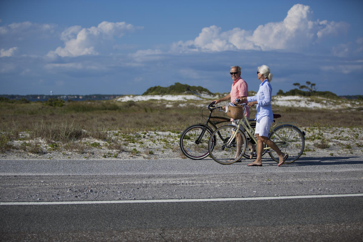 Couple biking on the Beach
