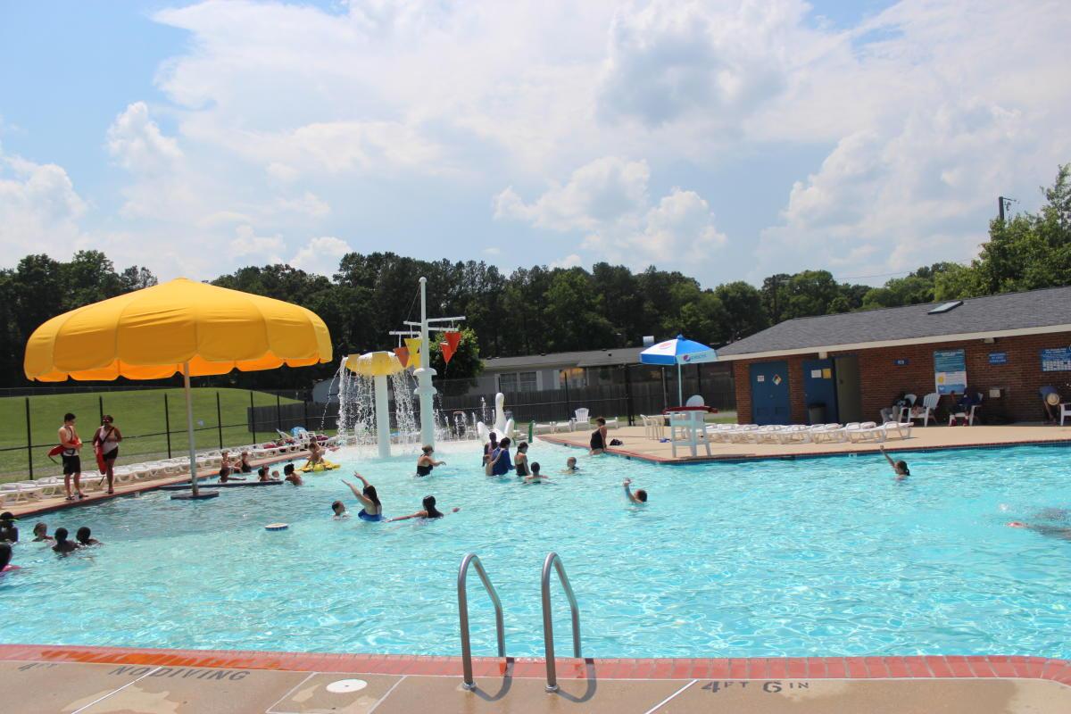 people swimming in graham park pool