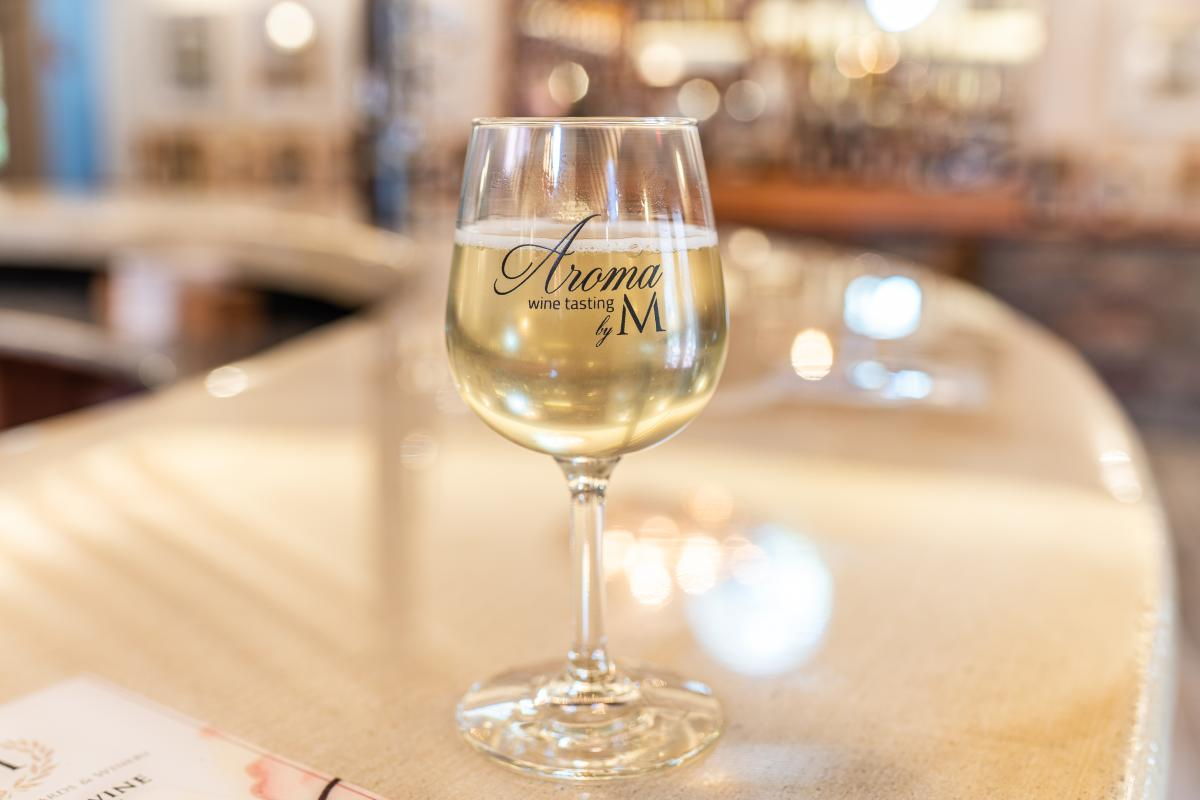 Aroma II glass of white wine on counter