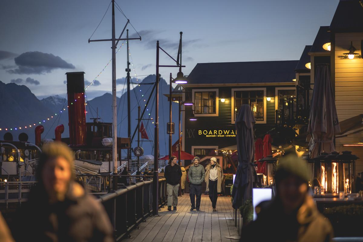 Friends walking through Steamer Wharf on a winter evening