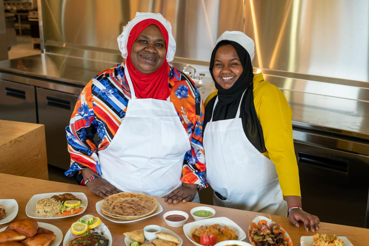 Two chefs in front of African food