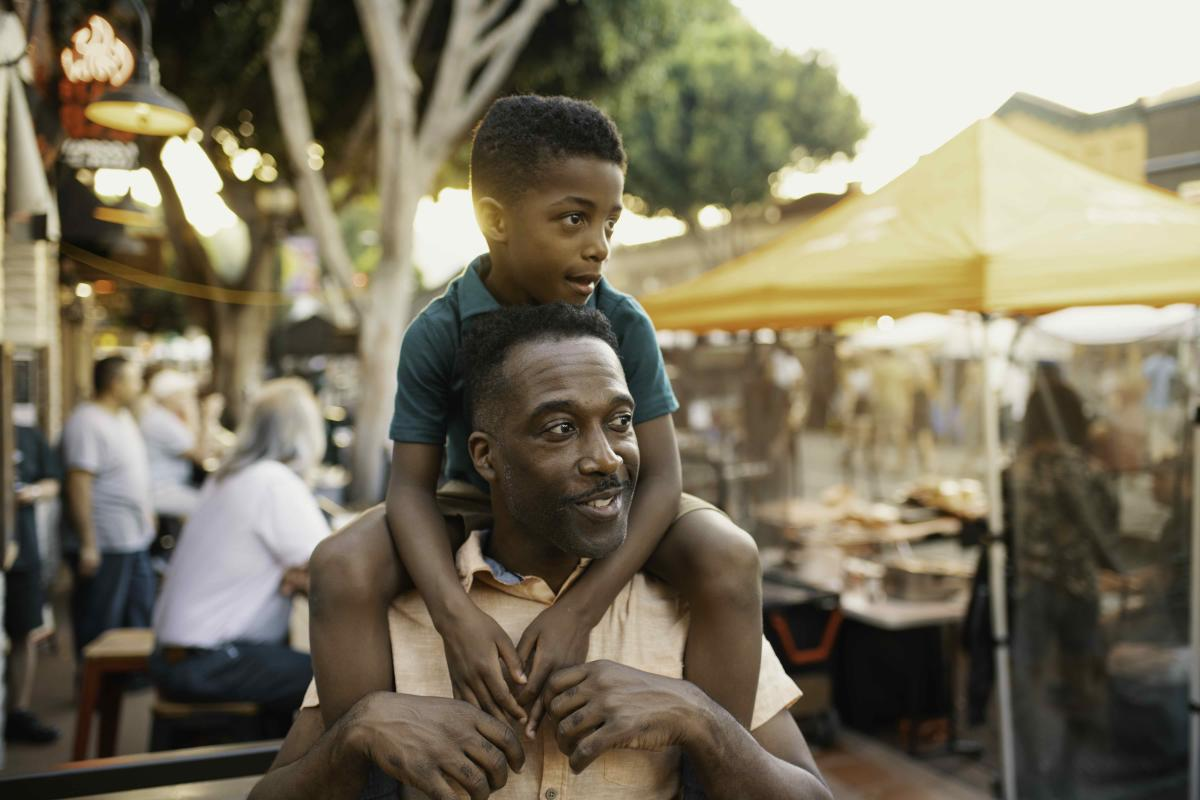 Father with his son on his shoulders at Farmers Market