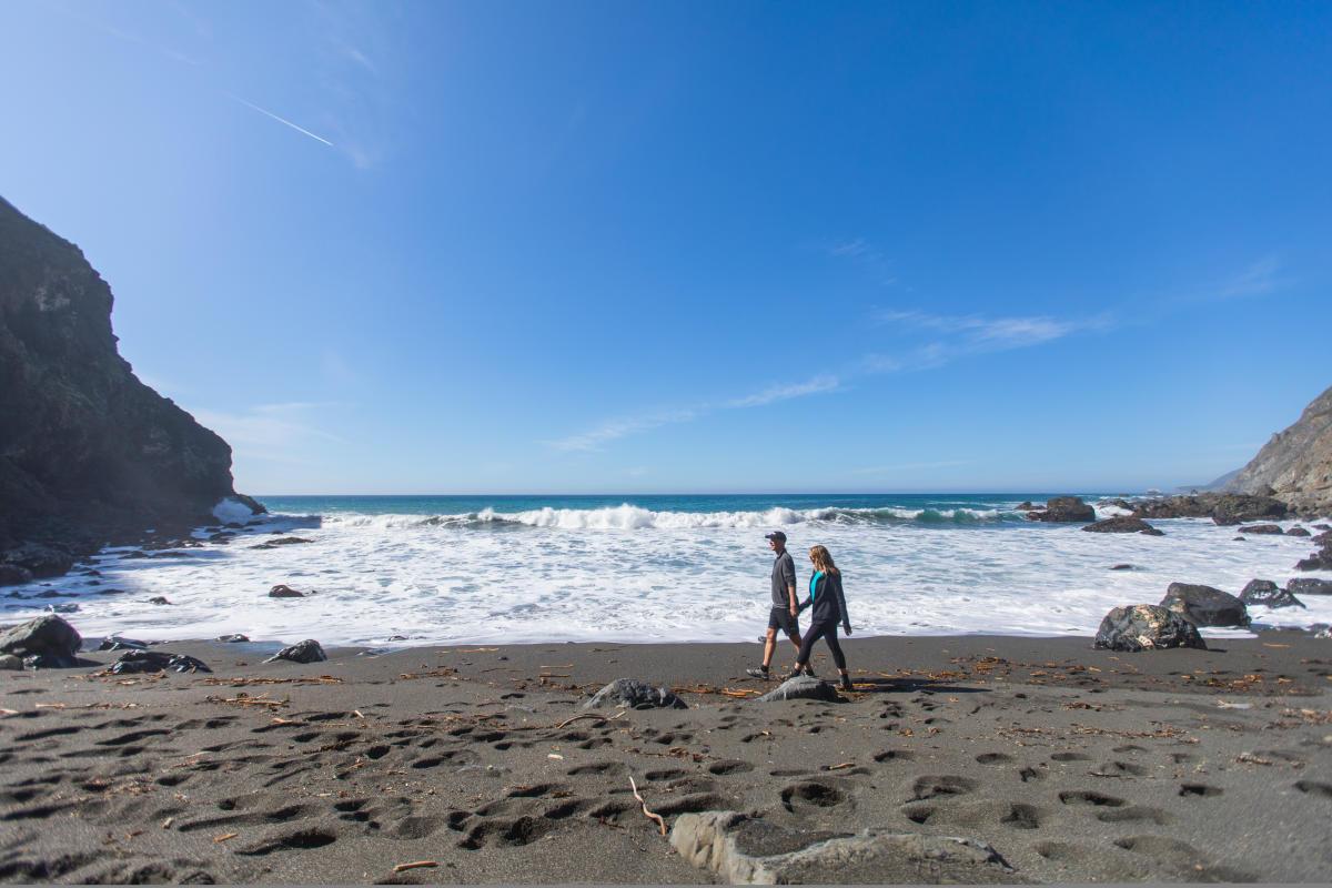 couple walking San Simeon beach