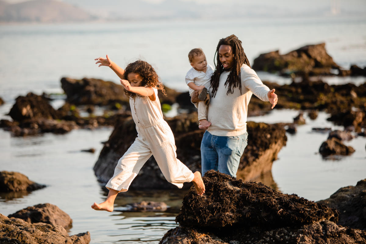 Family playing in tidepool near scenic Highway 1 in SLO CAL