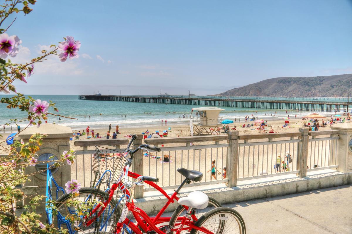 A bike parked at railing in Avila Beach