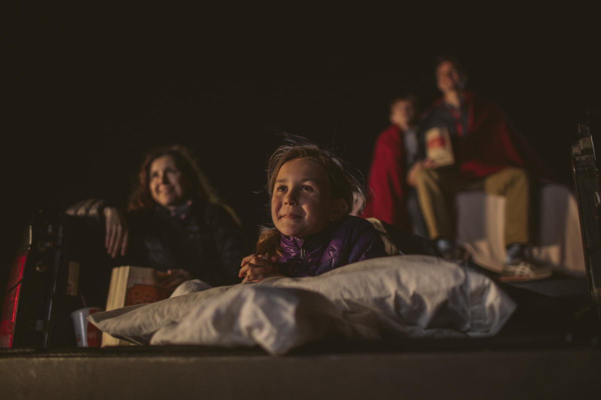 A family enjoying a drive in movie at Sunset Drive-In in SLO CAL