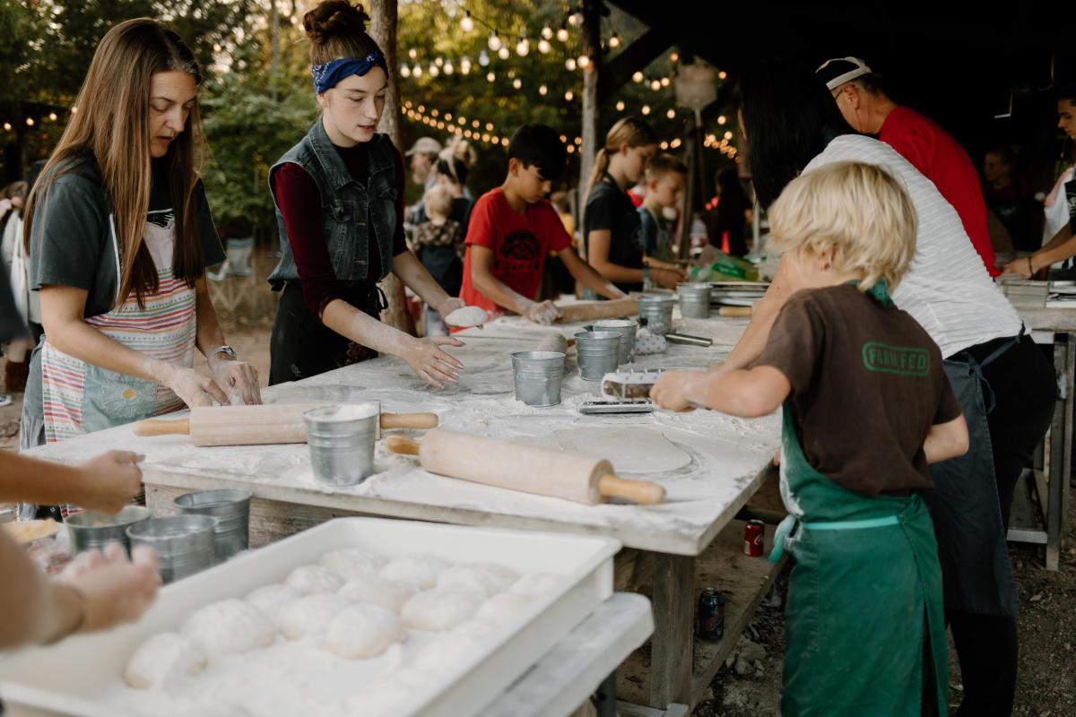 Kids making pizza at Millsap Farm Pizza Night