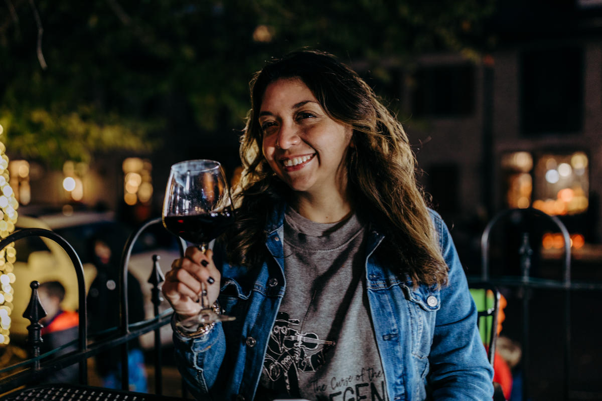 Woman dining on patio with tapas and wine