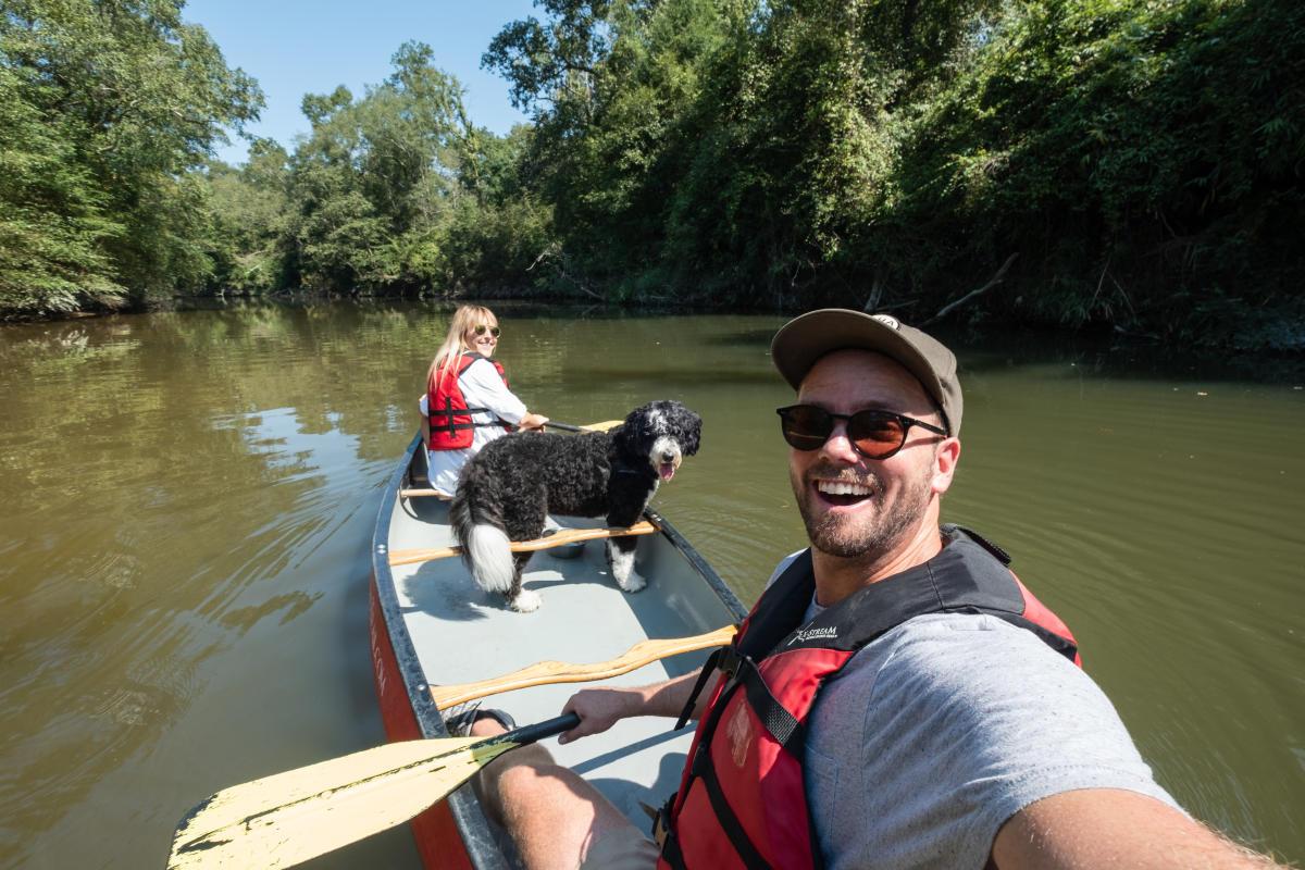 Canoe and Trail Adventures, canoe with dog, Bogue Falaya
