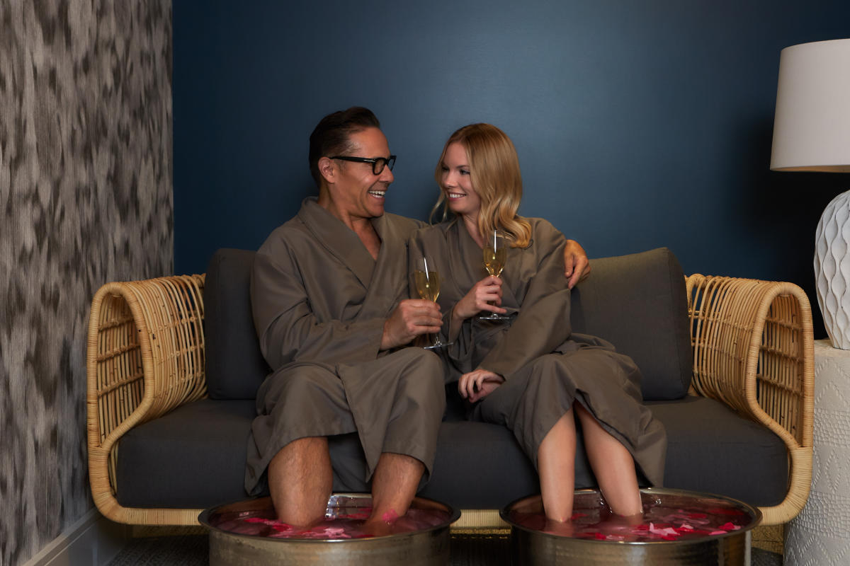 A couple at Drift, a Waterfront Spa in Huntington Beach