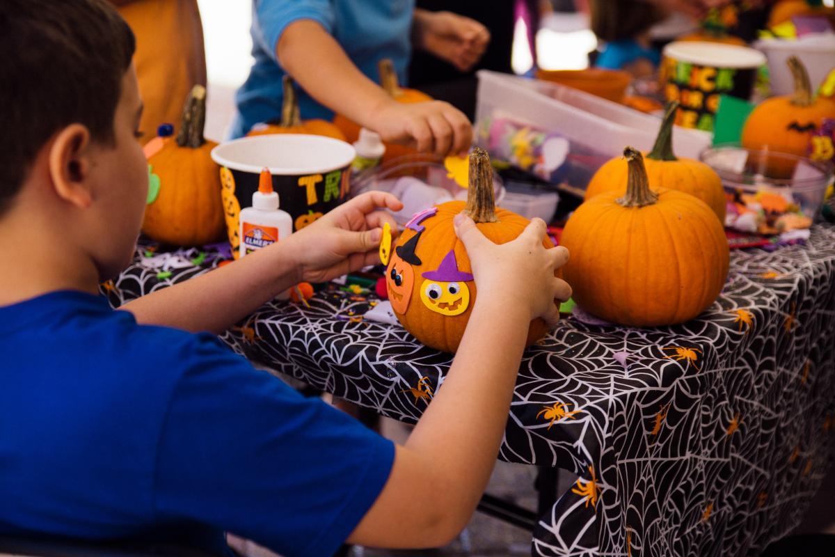 Kid painting pumpkins in Ybor City