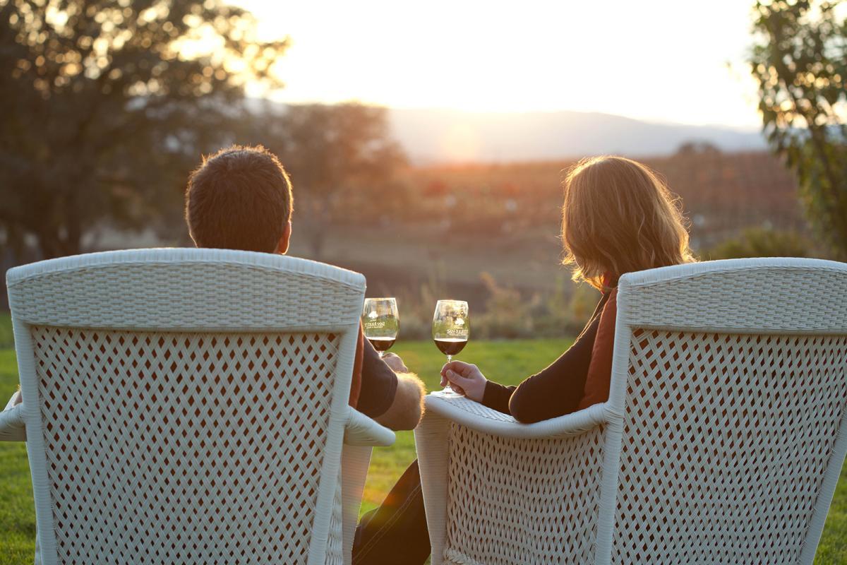 couple drinking wine at sunset_juice media credit_0