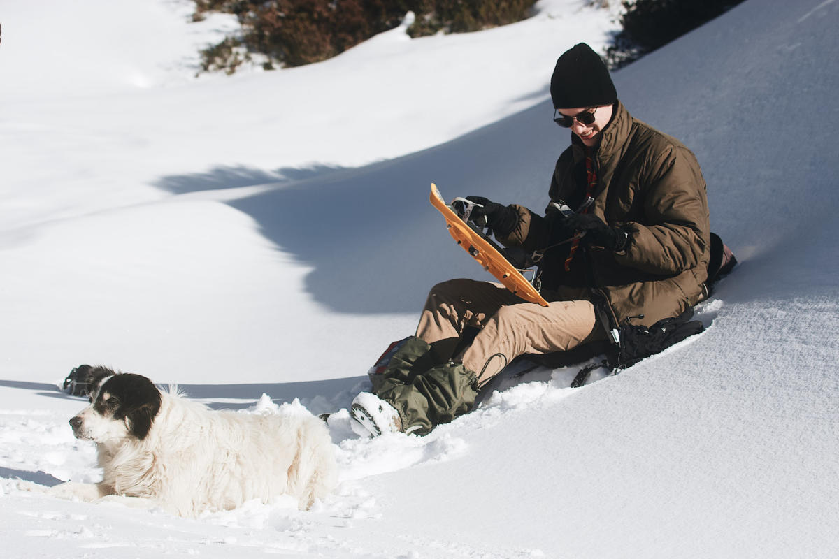 Snow shoer with dog