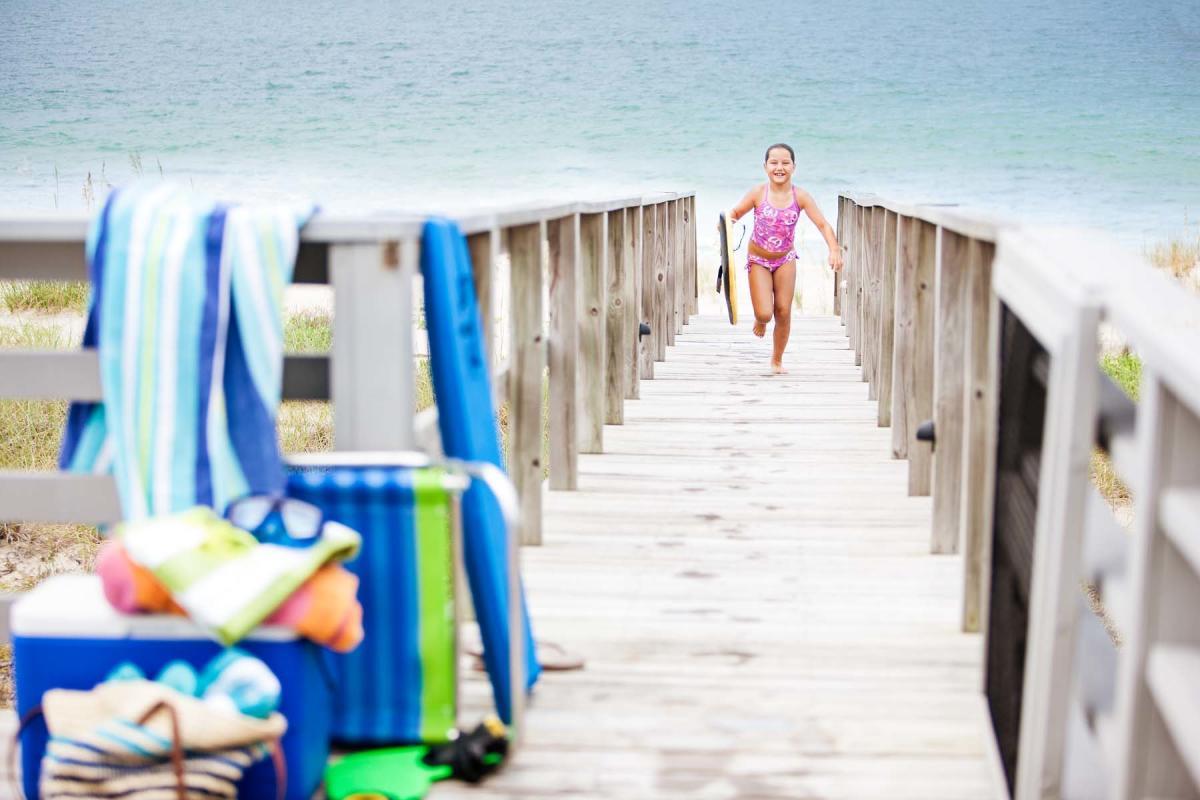 Child plays at Kure Beach NC