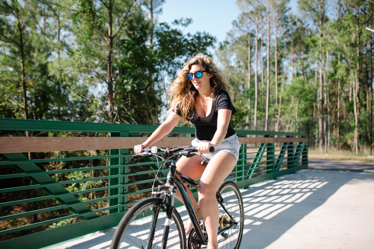 Girl biking the Island Greenway in Carolina Beach