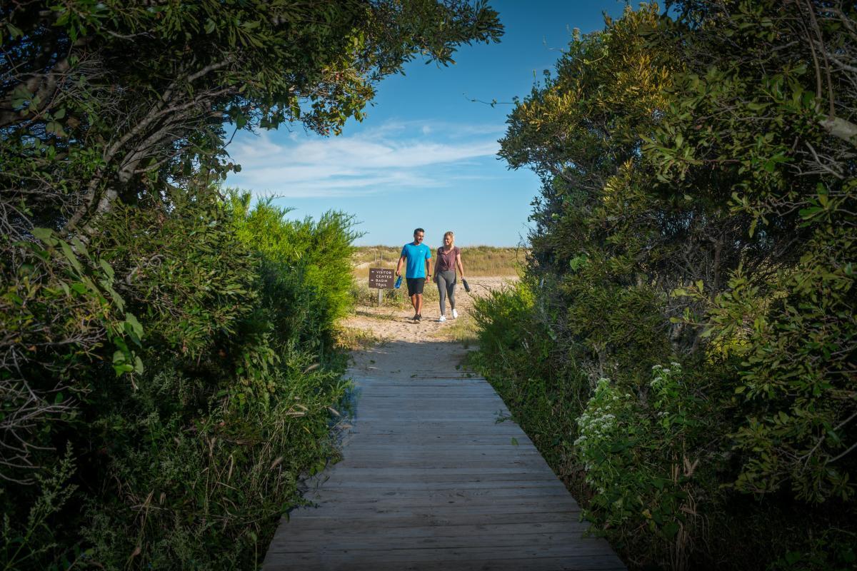Couple Walking On Basin Trail Fort Fisher On Kure Beach NC