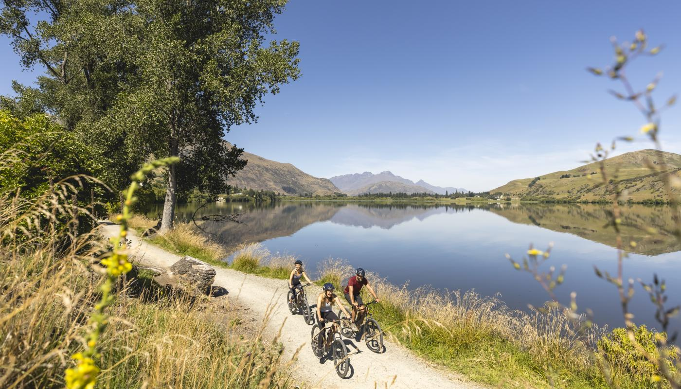 Group of friends biking around Lake Hayes