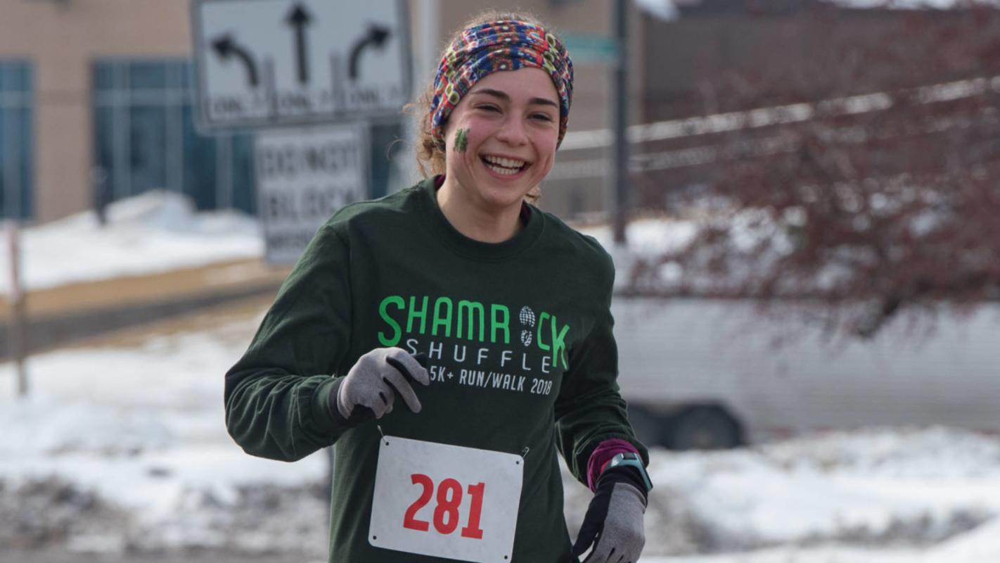 Girl running the Shamrock Shuffle
