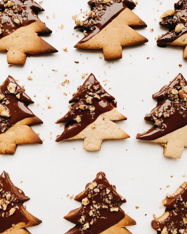 Christmas cookies in the shape of Christmas trees with chocolate on them