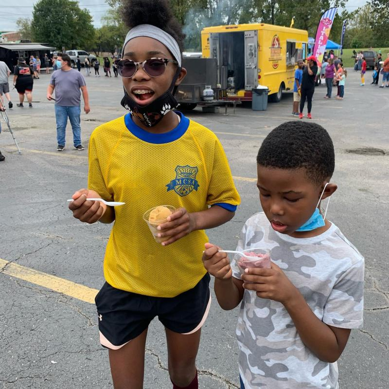 kids with sno cones near a food truck