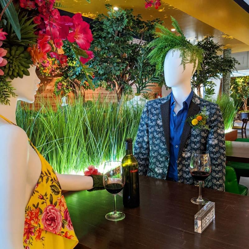 Mannequins with plants as hair at Hugo's Invitados in Irving, TX