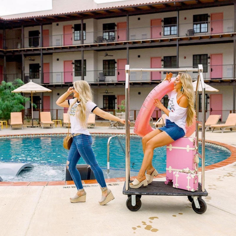 Texican Court girls pulling luggage