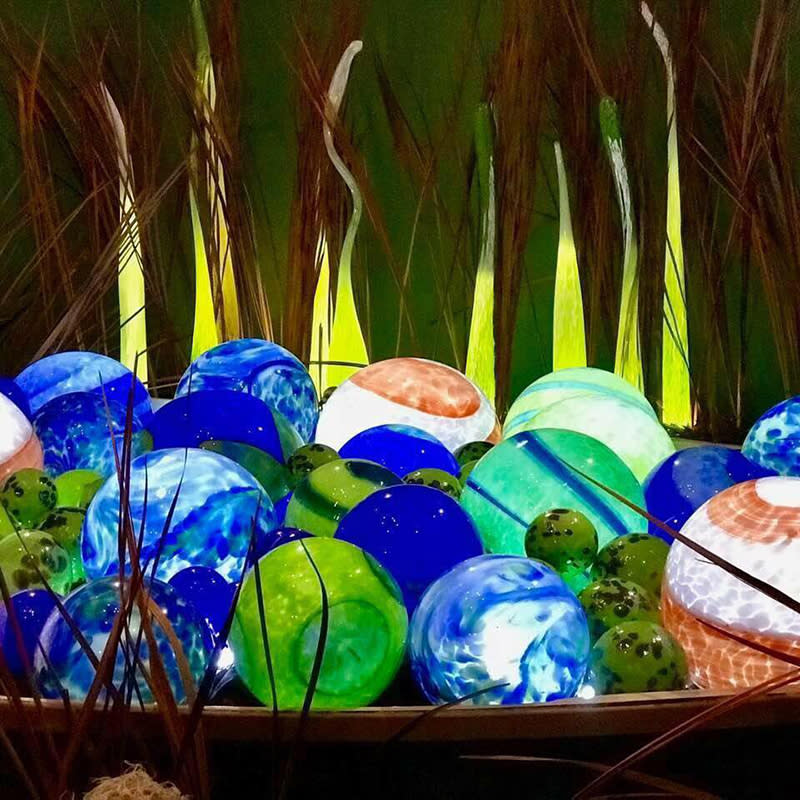 Blue and green glass orbs at Conway Glass