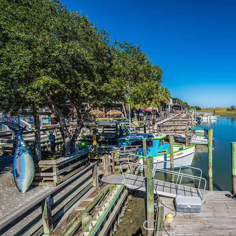 Murrells Inlet MarshWalk with boat docks along the walkway