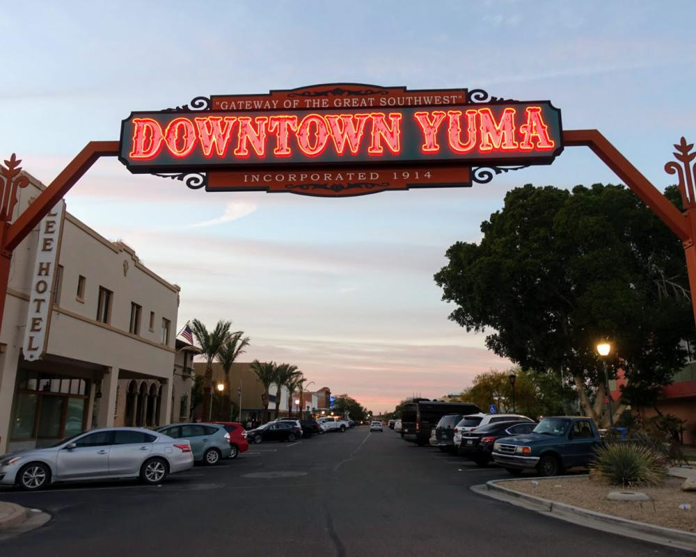 Downtown Yuma sign lit at twilight
