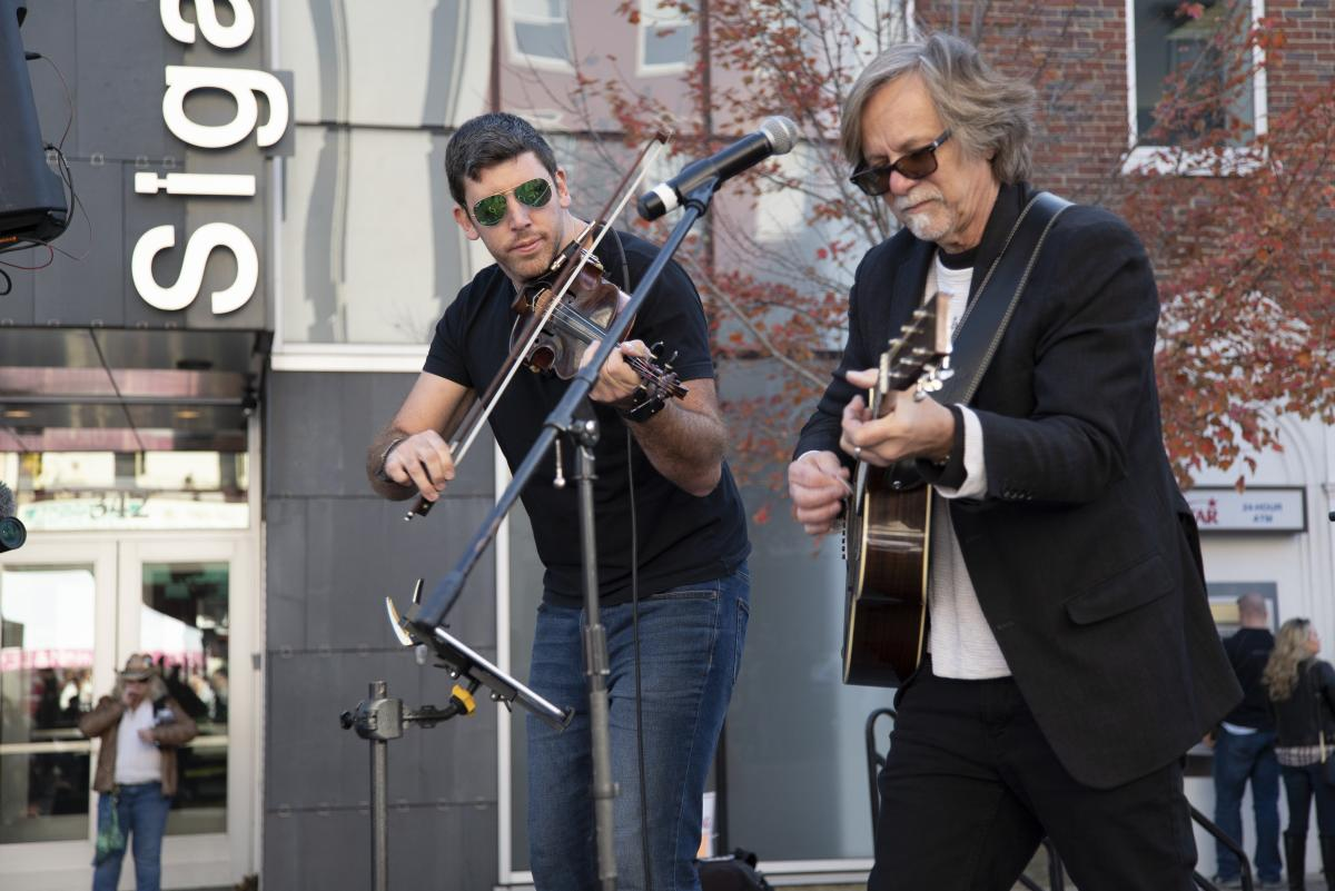 Musicians performing outdoors at PA Bacon Fest