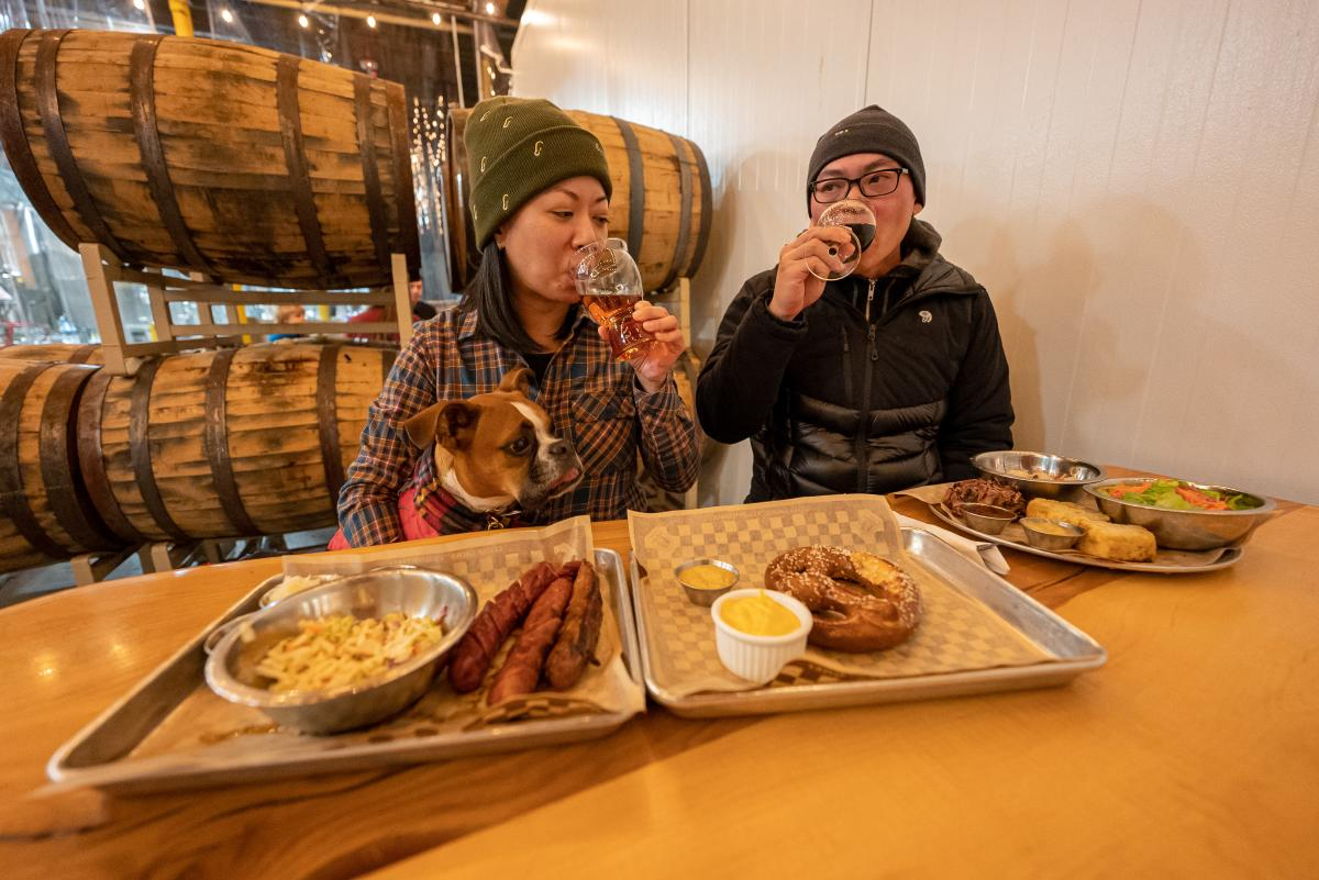 Couple dining with dog at Odin Brewing