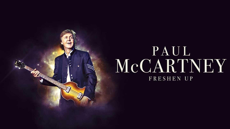 Paul McCartney holding a guitar