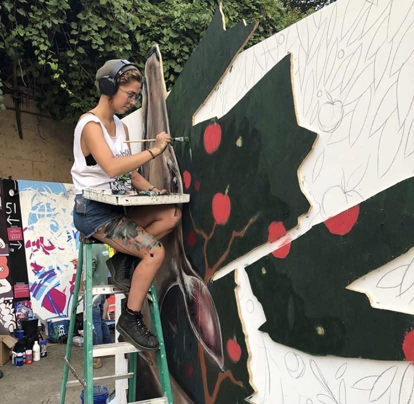 Mandi Caskey painting at Urban Scrawl