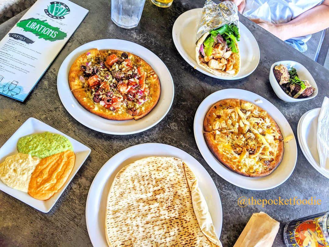 Mediterranean Tapas, hummus, pita bread and schwarma displayed on a table
