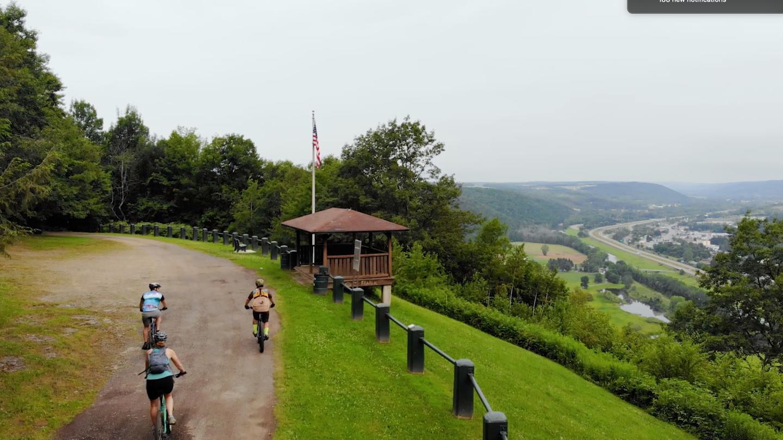 Mossy Bank Park Mountain Bike Trail Cyclists Biking at Overlook