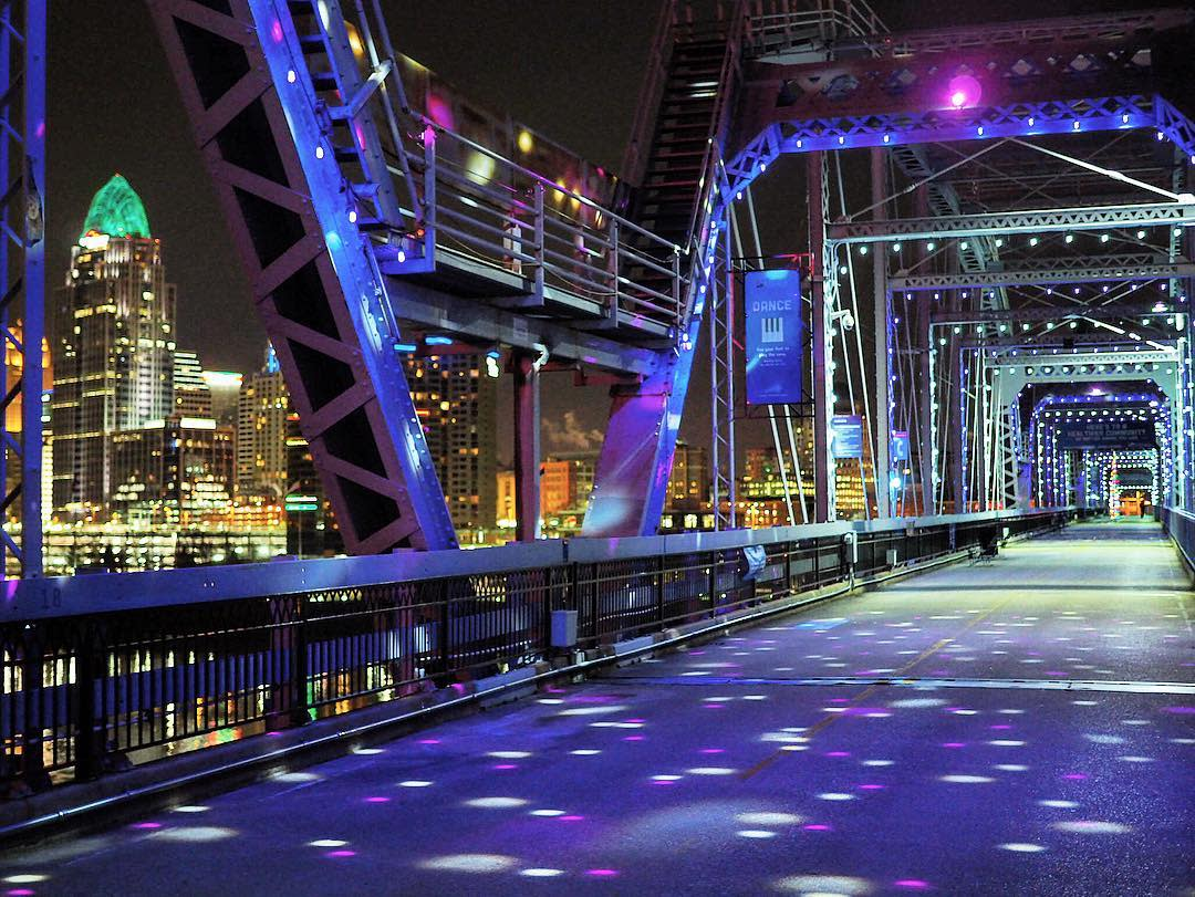 The Purple People Bridge across the Ohio river lighted up for the holidays with the Cincinnati skyline in the background, viewed from Newport, Ky.