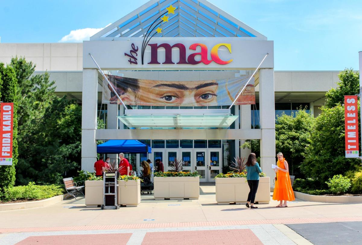 The exterior of the McAninch Arts Center with a banner to the Frida Exhibit