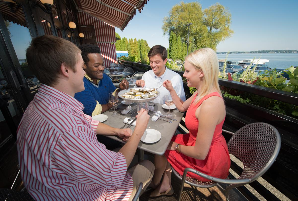A group of friends dine on oysters at Sardine, along Lake Monona.