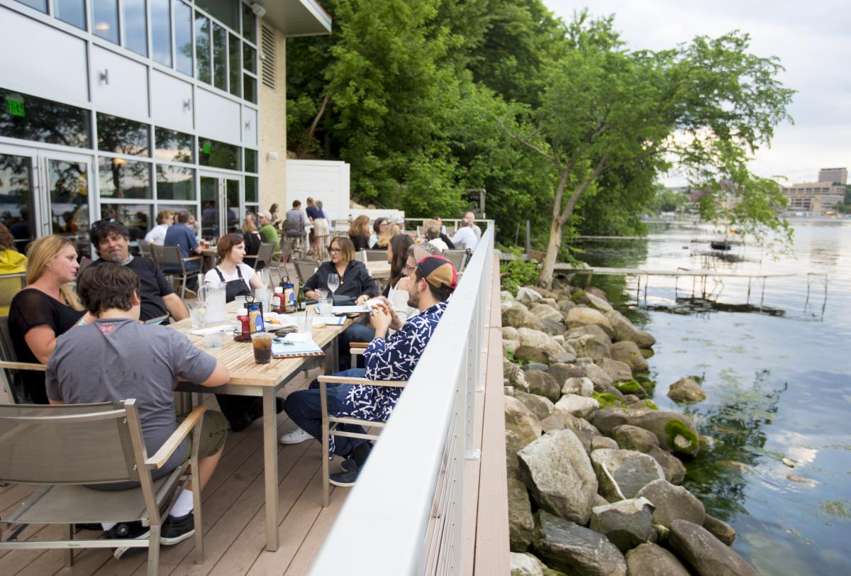 People dine at The Edgewater's Boathouse restaurant on Lake Mendota