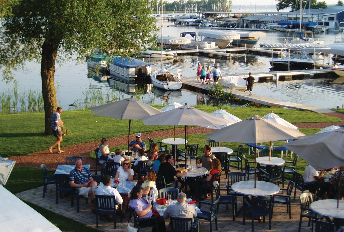 An outdoor patio along the waterfront at Mariner's Inn