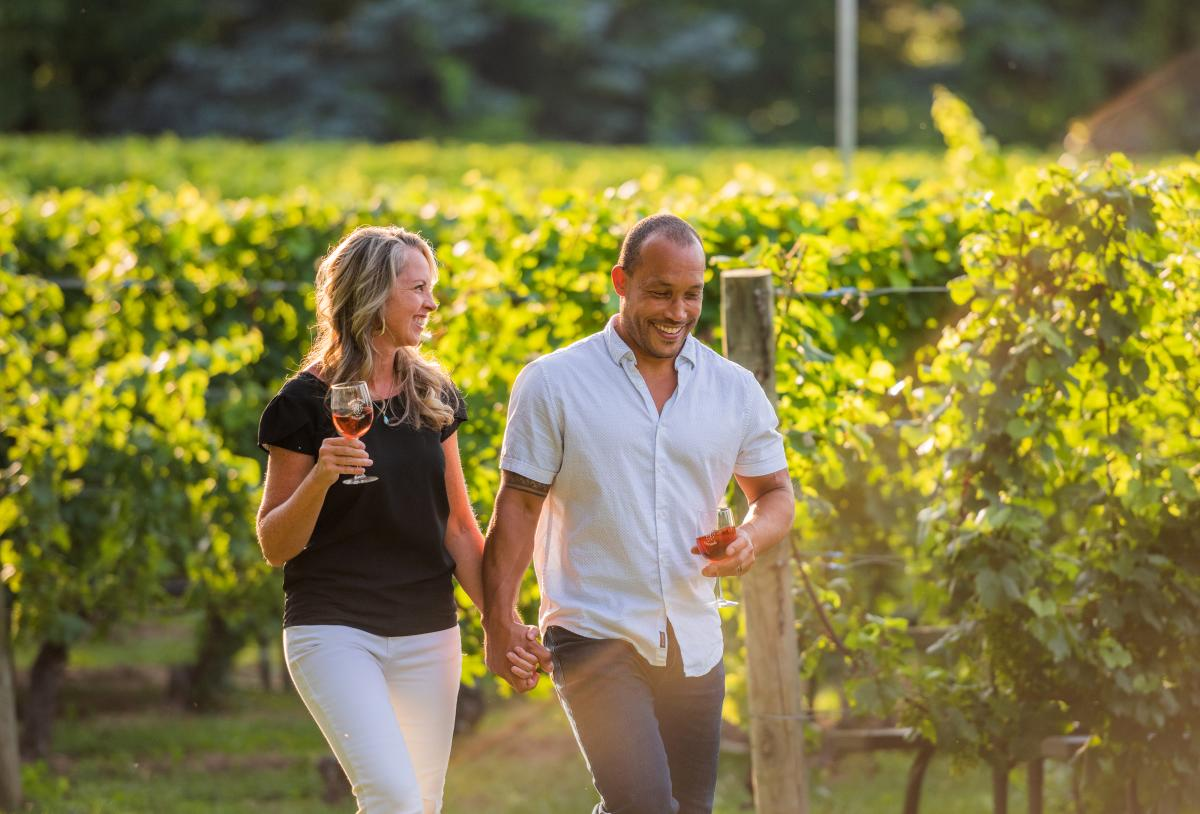 Couple drinking wine in the vineyard