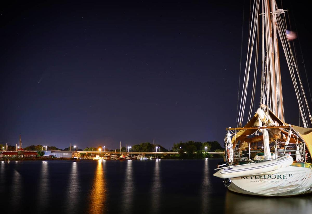 BaySail's Appledore Tall Ship docked with a starry night sky as the backdrop