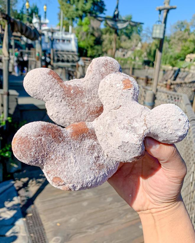 Image of three Mickey-shaped beignets.