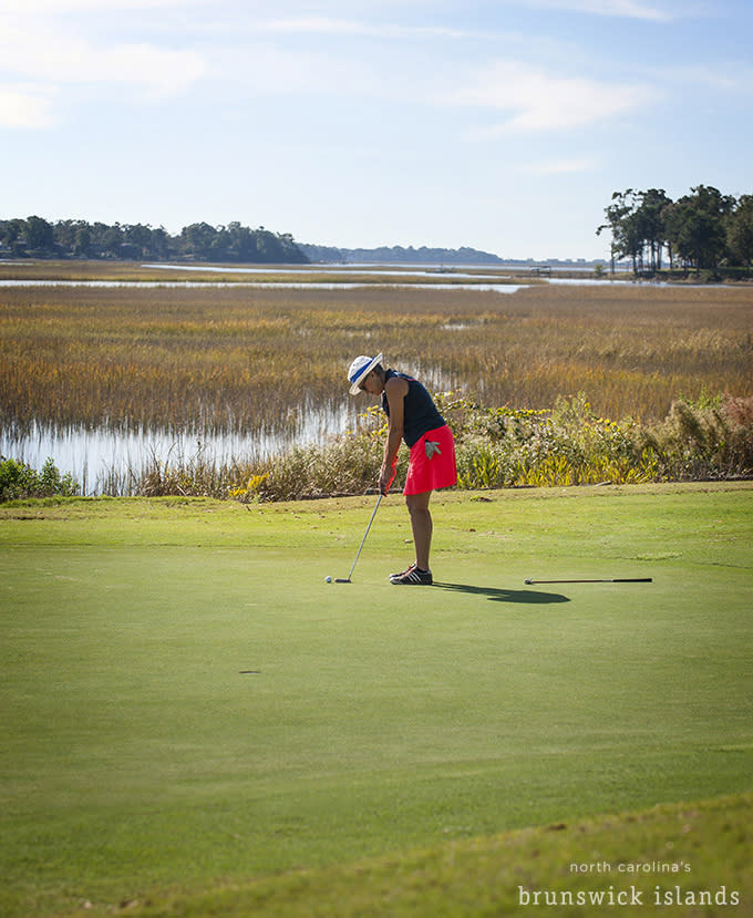 Woman Putting At The Rivers Edge Golf Club