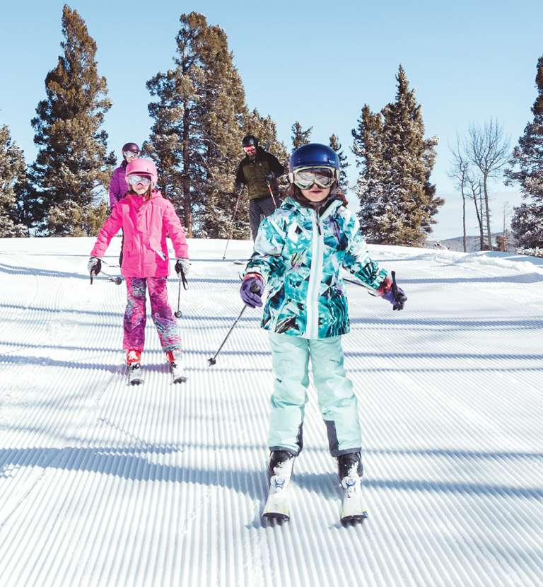 Two children skiing at Red River