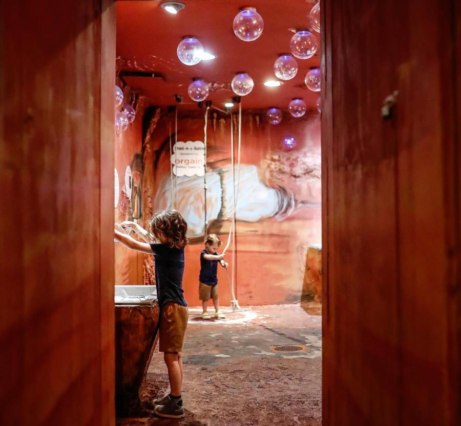 boys playing in a bubble cave