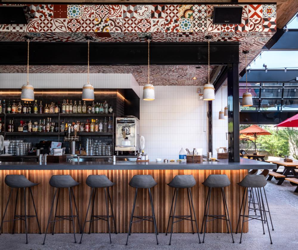 Outdoor patio bar stools at Leftys Brick Bar in Austin Texas